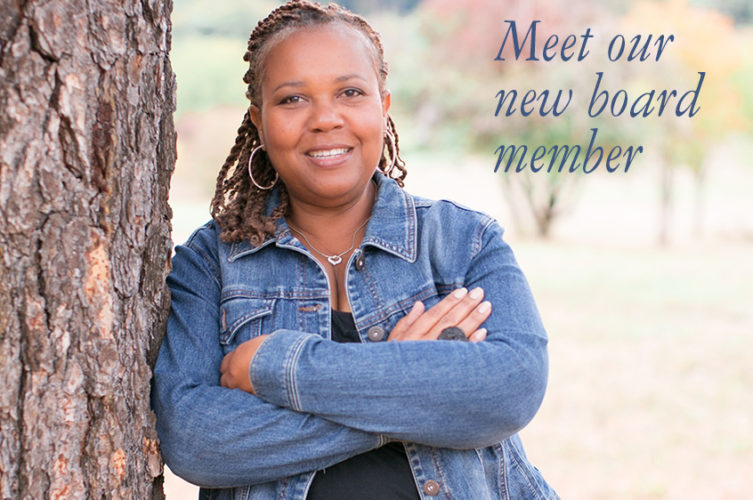 Outdoor photo of Donna Barber with words meet our new member