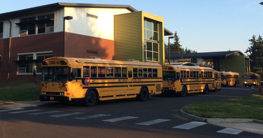 Buses parked outside of Ron Russell Middle School