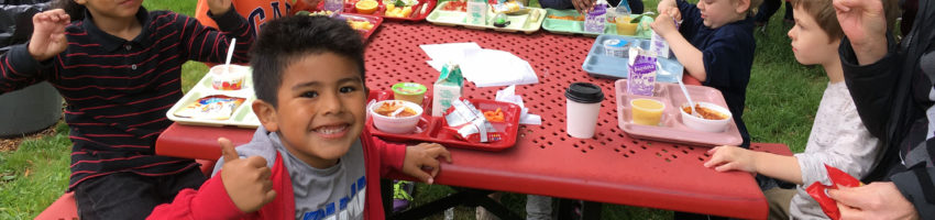 Elementary kids eating lunch outside