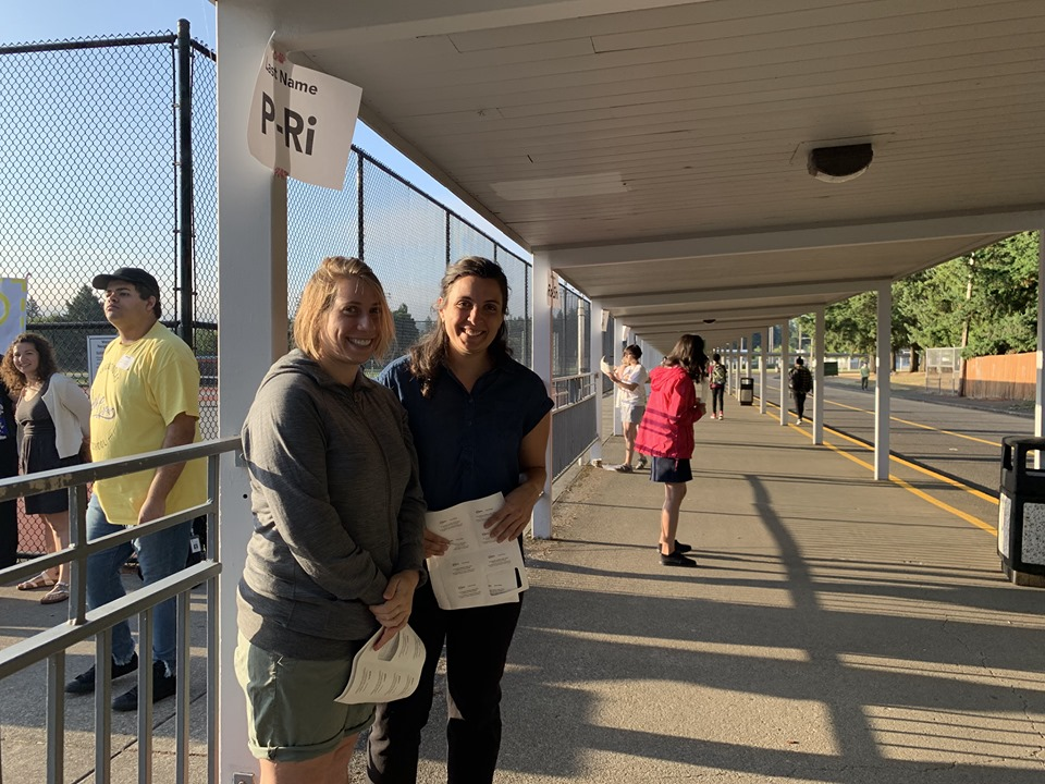 Staff members outside ready to greet and direct arriving students