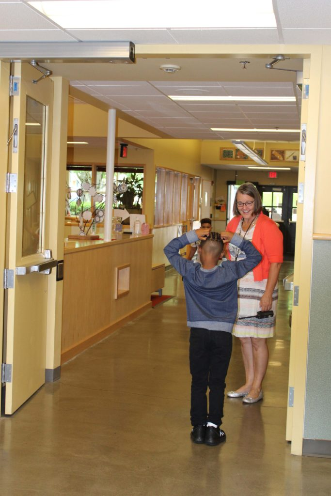 EB principal greeting an elementary student