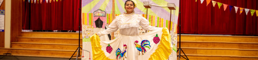 Student performer at Earl Boyles Event (colorful dress, festival decorations)