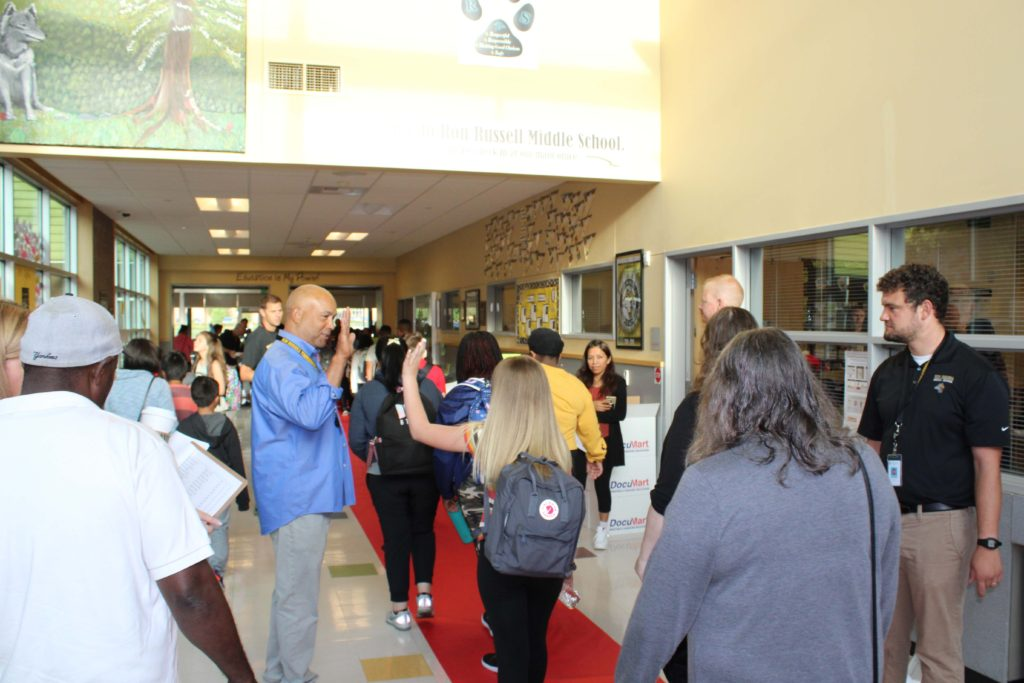 RRMS staff welcoming 6 grades as they enter the building