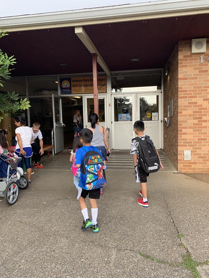 Students entering the VP front doors