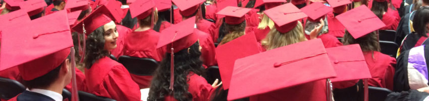 View from behind graduates seated at a DDHS graduation ceremony
